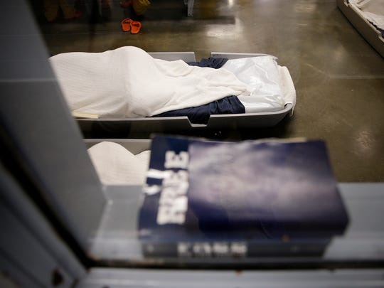 "Women sleep on ""boats,""  plastic beds, on the floor inside the Johnson County Jail in Franklin on June 6, 2016. The makeshift beds are being used due to jail overcrowding."