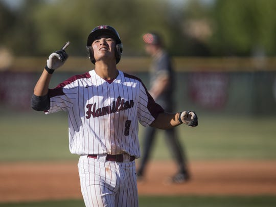 Hamilton's Tyler Wilson celebrates after hitting a