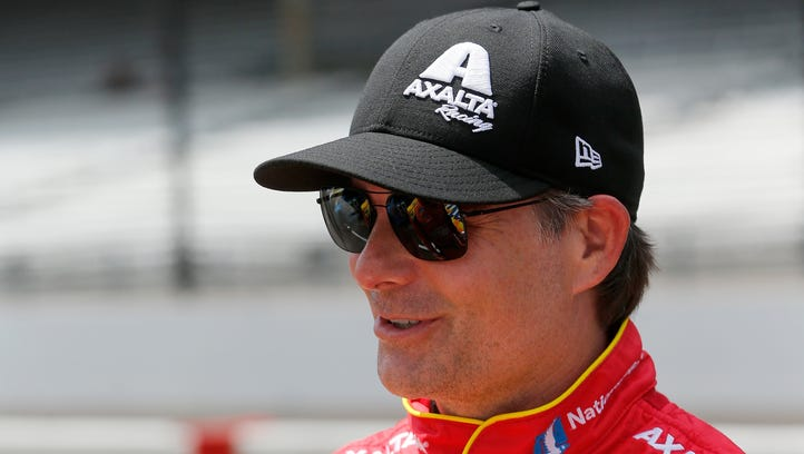 Driver Jeff Gordon, center, will be back in a race car today, substituting for Dale Earnhardt Jr. in the Brickyard 400 in Indianapolis.