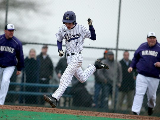 North Kitsap junior Max Larsen scored the winning run in the Vikings' 3-2 win over Olympic.
