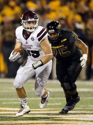 Mississippi State linebacker Richie Brown (39) runs away from Southern Miss Golden Eagles offensive lineman Oliver Bates (75) after an interception in the second half of their game at M.M. Roberts Stadium. Mississippi State won, 34-16. Mandatory Credit: Chuck Cook-USA TODAY Sports