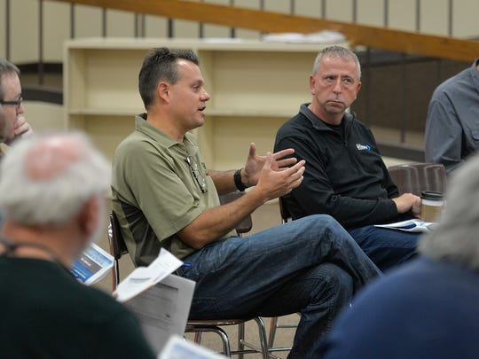 Michael Gohman, president of W. Gohman Construction, talks Saturday, Sept. 17, 2016, about the costs to renovate the current Technical High School site versus building a new school as St. Cloud Mayor Dave Kleis, right, listens.