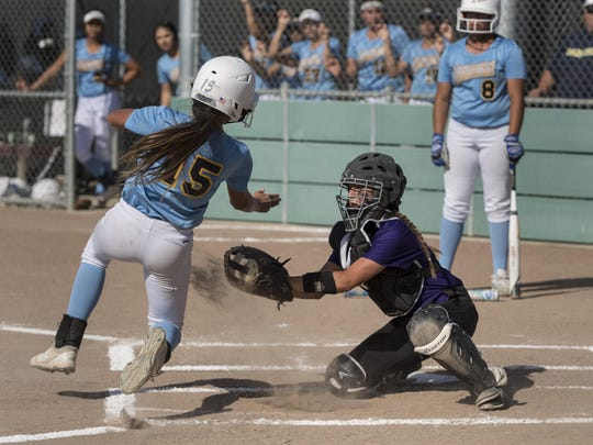 Mission Oak catcher Kaylee Melendez outs Monache's Evette Mendoza in an East Yosemite League high school girls softball on Tuesday, May 2, 2017.