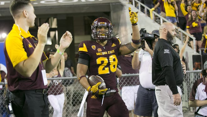"ASU defensive back Viliami ""Laiu"" Moeakiola reacts after scoring a touchdown on an interception during the fourth quarter of the college football game against Cal at Sun Devil Stadium in Tempe on Saturday, September 24, 2016. ASU won the game 51-41."