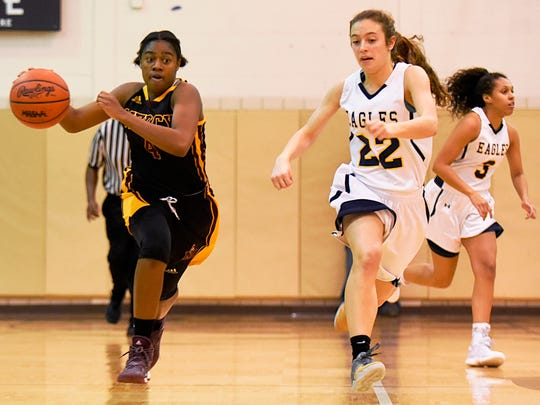 Mercy's Chloe Godbold (left) pushes the ball with Hartland's Michelle Moraitis in hot pursuit.