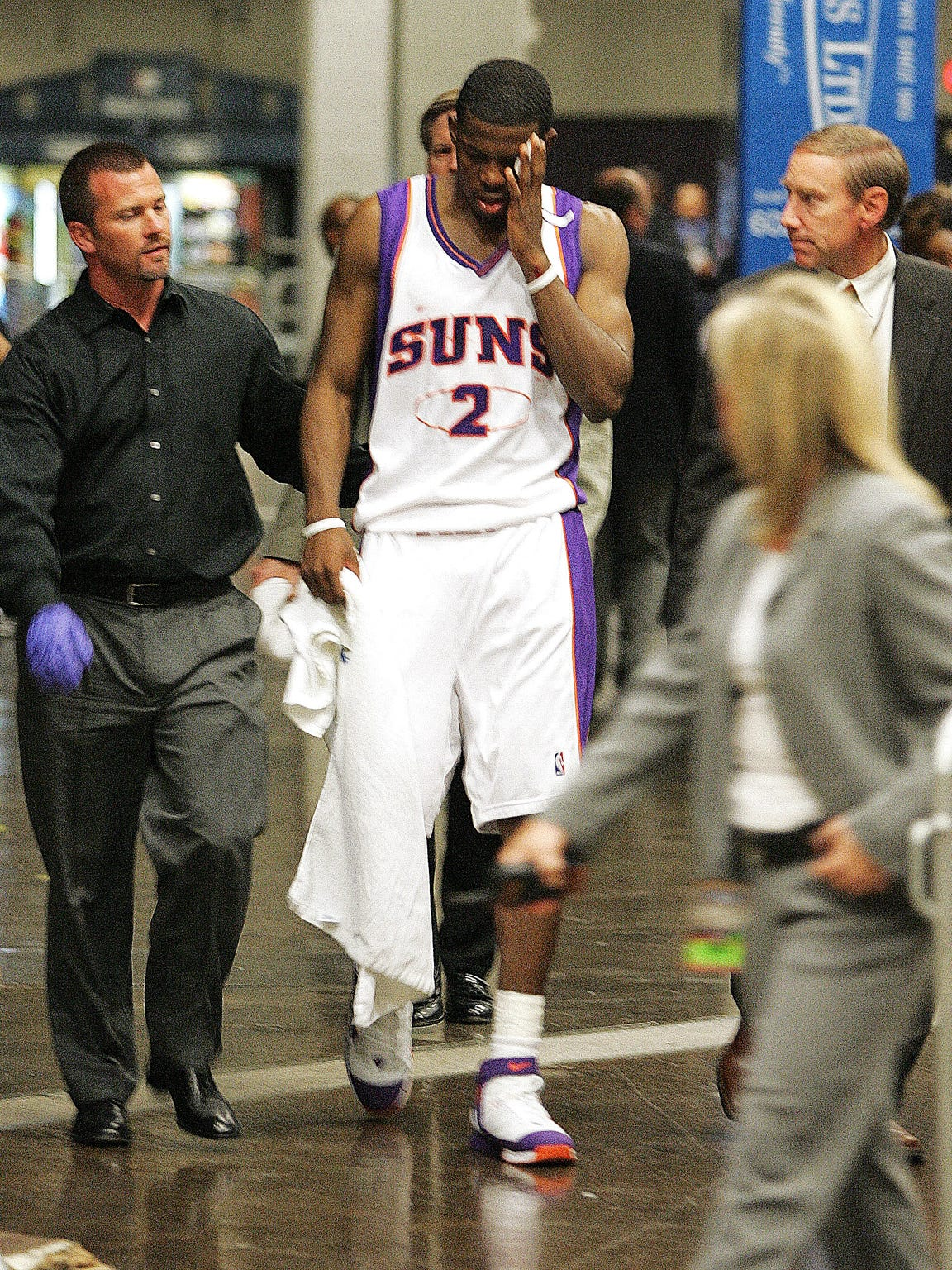 Phoenix Suns' Joe Johnson leaves the arena after being