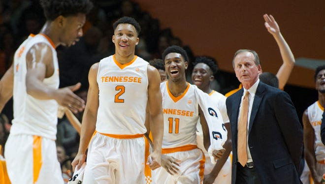 From left, Tennessee's Robert Hubbs III is greeted by Grant Williams, Kyle Alexander coach Rick Barnes during Saturday's game against Mississippi State at Thompson-Boling Arena.