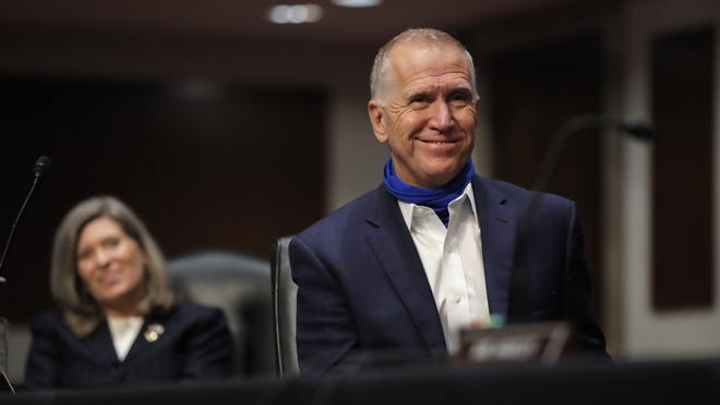 Sen. Thom Tillis in this June 11 photo in Washington, D.C., is wearing a neck gaiter that he pulls over his mouth and nose to serve as a face mask to avoid spreading the coronavirus and its COVID-19 disease. On Wednesday, Tillis told constituents a vaccine should be coming to market in December and January, but people must to take precautions — use masks, avoid big groups of people, and practice social distancing — to avoid preventable COVID deaths before immunizations are widespread.