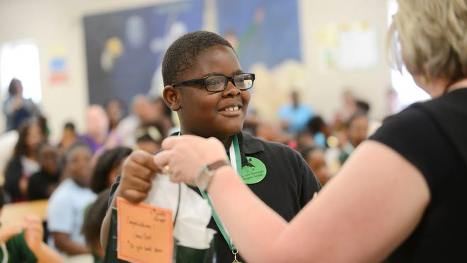 Joey Carr, a fourth-grader at Isaac Lane Elementary School, was awarded for most Accelerated Reader points Wednesday afternoon. Carr said he read about 45 books and earned 226 points.