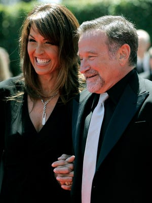 Robin Williams, right, and Susan Schneider arrive at the Creative Arts Emmy Awards in Los Angeles on Aug. 21, 2010.