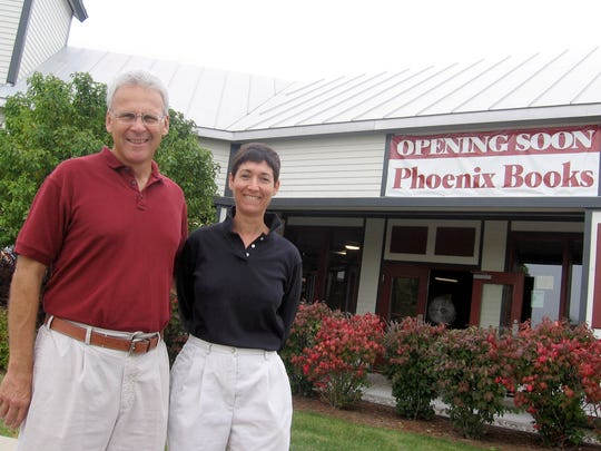 Mike DeSanto and Renee Reiner stand in front of their soon-to-be Phoenix Books in Essex, in September in 2007.