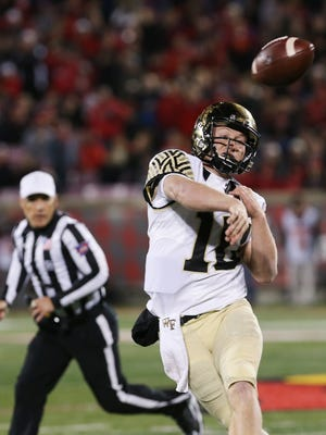 Wake Forest's John Wolford (10) passes against U of L during their game at Papa John's Cardinal Stadium.