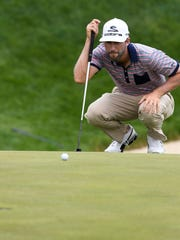 Chris Baker, from Brownstown, preparing to putt on number 17 during the first round of the United Leasing & Finance Championship golf tournament at Victoria National Golf Course Thursday, April 20, 2017.