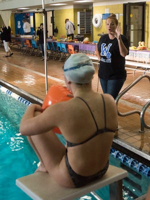 Washington High Shcool Swim team coach, Megan Olberholtzer gives her team a pep talk before the end of practice Wednesday, Oct. 25, 2017. The Wildcats are preparing for the district championship meet on Friday at UWF.