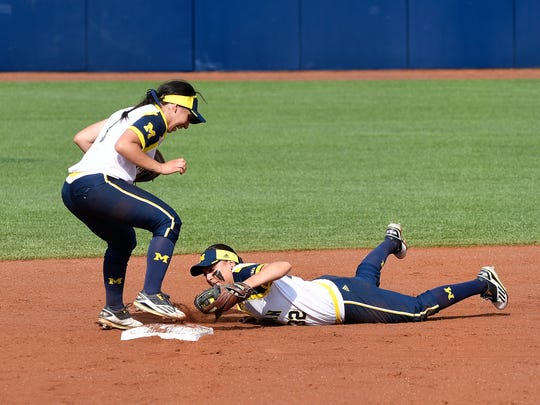 Michigan second baseman Sierra Romero reaches out to tag second base for a force out after making a diving stop on a grounder up the middle to get the last out of the game.