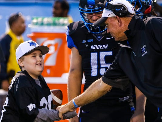 636441356958378581-Colton-Sheets-is-greeted-on-the-sideline-by-Coach-Stockstill.jpg