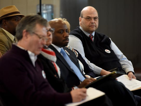 Bob Guarasci, CEO of NJCDC, listens to Paterson mayoral