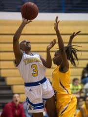 Martin County's KeArra Smith puts up a shot against