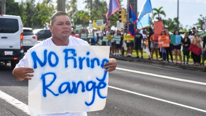 Dededo resident Steve Cruz and other supporters of the Prutehi Litekyan: Save Ritidian movement participate in a peaceful protest and a wave along Marine Corps Drive at Adelup on Tuesday, Aug. 29, 2017. The protest was held to call upon Gov. Eddie Calvo to put a stop to the live-fire training range complex to be built on Northwest Field at Andersen Air Force Base in Yigo, but the governor was out of the office at the time of the protest.
