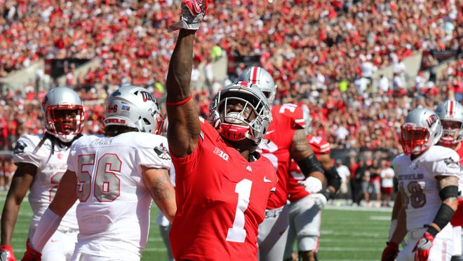 Ohio State's Johnnie Dixon celebrates after catching a 16-yard touchdown pass in the first quarter against UNLV.