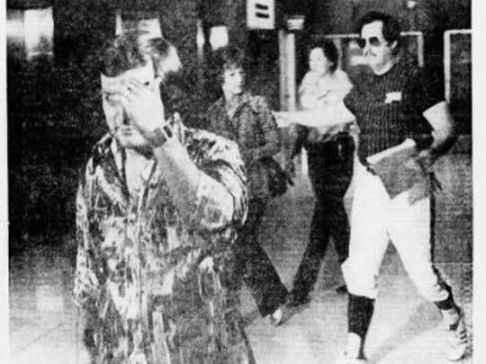 This clipping from The Arizona Republic in 1976 shows Robert Lettiere avoiding a camera after providing testimony implicating John Adamson in the car bombing of Republic reporter Don Bolles.