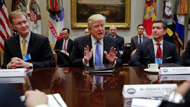 From left, Corning Inc. CEO Wendell Weeks, President Donald Trump and Alex Gorsky, chairman and CEO of Johnson & Johnson, at a breakfast with business leaders Jan. 23 in the Roosevelt Room of the White House.