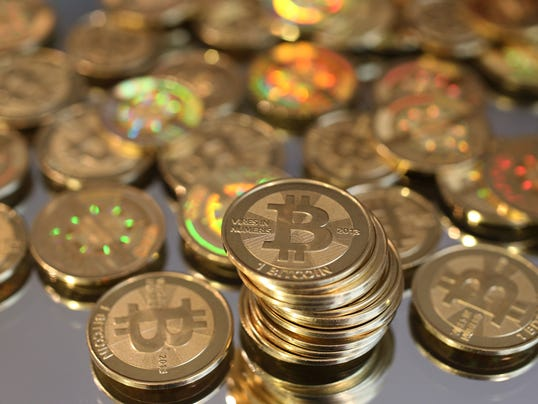 Las Vegas casinos adopt new form of currency: Bitcoins 1390316530000-A03-BITCOINS-22
