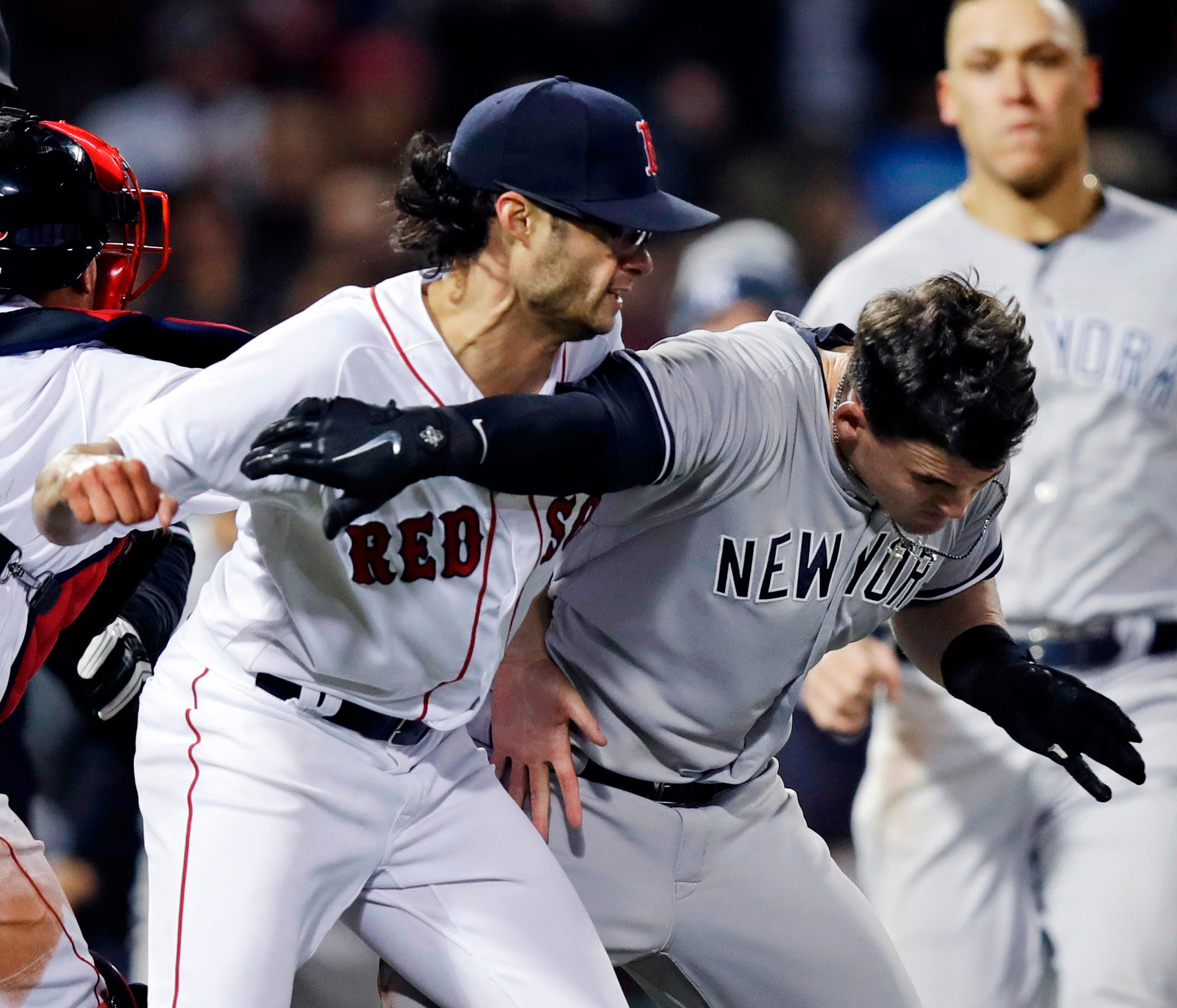 New York Yankees' Tyler Austin, right, scuffles with Boston Red Sox relief pitcher Joe Kelly, after being hit by a pitch during the seventh inning of a baseball game at Fenway Park in Boston, Wednesday, April 11, 2018. (AP Photo/Charles Krupa) ORG XM