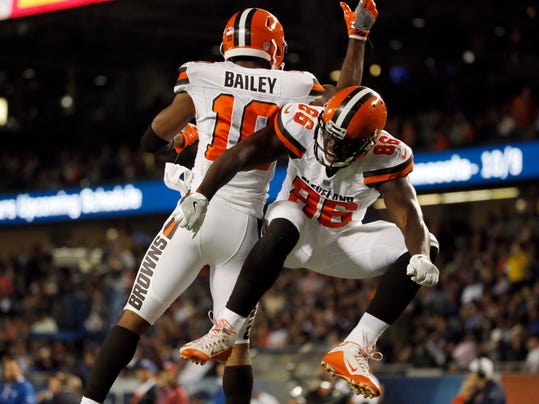 Cleveland Browns' Randall Telfer (86) celebrates with Rasheed Bailey (10) after scoring a touchdown during the second half of an NFL preseason football game against the Chicago Bears, Thursday, Aug. 31, 2017, in Chicago. (AP Photo/Nam Y. Huh)