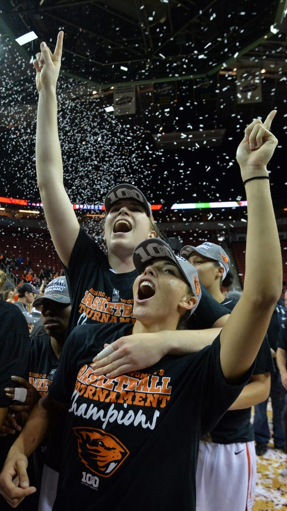 Mar 6, 2016; Seattle , WA, USA; Oregon State Beavers center Ruth Hamblin (left) and guard Gabriella Hanson celebrate after the championship of Pac-12 Conference womens tournament against the UCLA Bruins at KeyArena. Oregon State defeated UCLA 69-57. Mandatory Credit: Kirby Lee-USA TODAY Sports