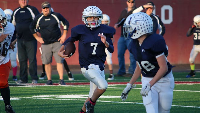 Granville Navy's Carsyn Crouch (7) follows Christian Hilton (28) after reversing field on a scramble Sunday during a 29-6 victory against Heath Brown during the Licking County League Youth Football Varner Division final at White Field.