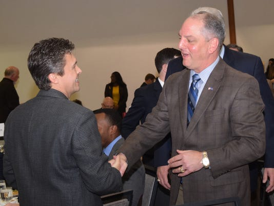 Reldon Owens (left), shakes hands with La. Gov. John Bel Edwards at the Central Louisiana Chamber of Commerce luncheon Wednesday where Edwards was the featured speaker.