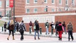 Iona College students walk on campus in New Rochelle.