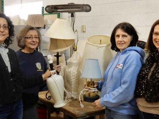 From left: Barbara McCloskey  Janice Blinder (co-chair), Karen Lazur (co-chair) and Nancy Fitch from the Women's Club of Denville-Rockaway, help with organizing the lighting section of the ReStore.