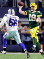 Packers quarterback Aaron Rodgers throws against Cowboys