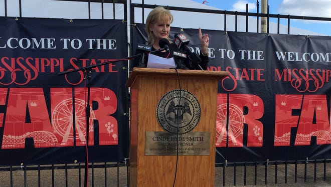 Mississippi Agriculture Commissioner Cindy Hyde-Smith discusses fair security at a press conference Monday.