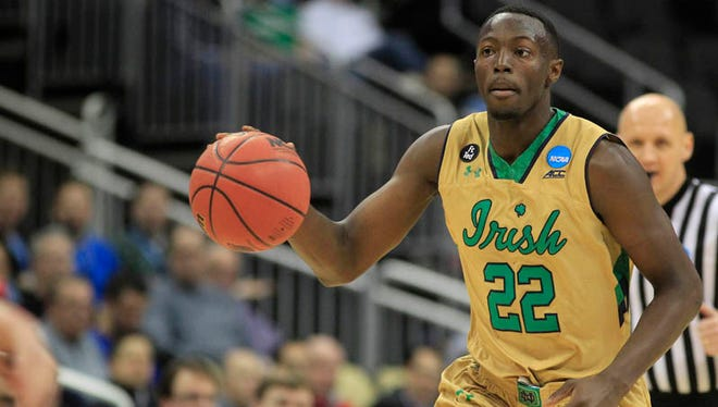 ; Notre Dame Fighting Irish guard Jerian Grant (22) dribbles the ball during the first half against the Northeastern Huskies in the second round of the 2015 NCAA Tournament at Consol Energy Center.