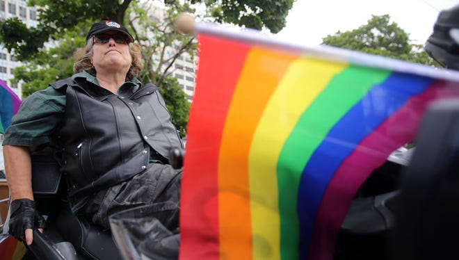 """Sandee Soloway of Ann Arbor is a part of """"Dykes on Bikes,"""" a group that participates in the Pride Festival."""