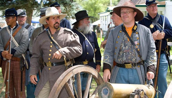 Fort Stanton reenactment soldiers get ready to reenact an 1870s battle between them and the escaped gang members.