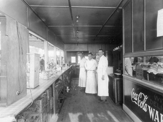Inside Ackerman's, circa 1940s. Customers placed their orders at the counter at left.