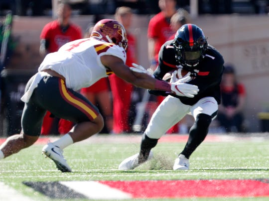 Iowa State defensive back Evrett Edwards tackles Texas Tech wide receiver Quan Shorts in the first quarter of an NCAA college football game, Saturday, Oct. 21, 2017, at Jones AT&T Stadium in Lubbock, Texas.