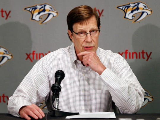 FILE - In this April 14, 2014 file photo, Nashville Predators general manager David Poile answers questions at a news conference in Nashville, Tenn. The Predators have taken their biggest step toward becoming more offensive by hiring Peter Laviolette, and now Poile is looking to give his new coach some help in scoring more goals one way or another. (AP Photo/Mark Humphrey, File)