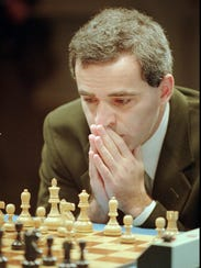 Garry Kasparov makes the first move in his final match