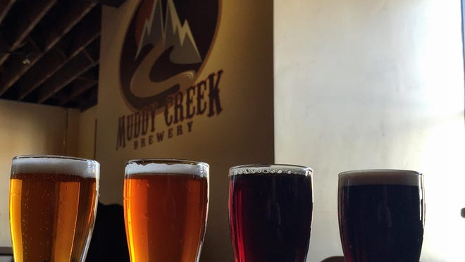 A flight of beer at the Muddy Creek Brewery in Butte catches the afternoon sun.