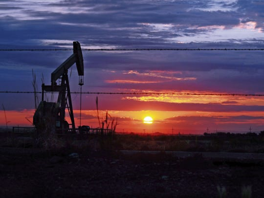 A pumpjack runs day and night off County Road 31 just