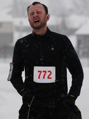 Marvin Schmitz catches his breath after finishing second Saturday, Feb. 10, 2018 during the Chili Heart 5K.