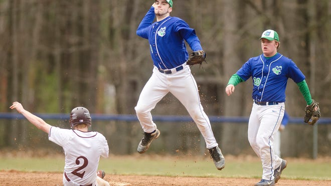 Colchester shortstop Derek Sanderson, center, leaps to avoid the slide of Mount Abraham's Michael White (2) while turning a double play on Saturday.