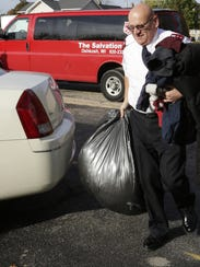 Capt. Don Karl of The Salvation Army Oshkosh carries