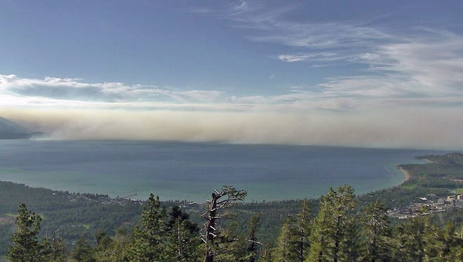 This undated photo provided by the University of Nevada Reno, shows smoke from the King Fire in a view north across Lake Tahoe in South Lake Tahoe, Calif. University researchers are helping federal forest and range managers expand the use of cameras to spot wildfires at Lake Tahoe to the tops of mountains in remote parts of northeast and central Nevada, including one north of Battle Mountain that gave an early warning of a fire more than 100 miles away in Oregon. (University of Nevada Reno via AP)