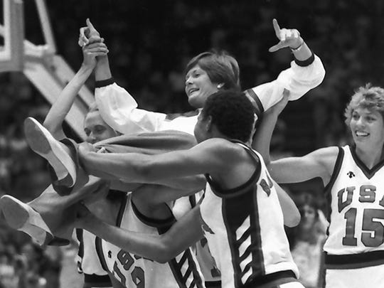 Summitt's U.S. basketball team members carry her off the court following their 85-55 gold medal win at the Olympic Games in  Los Angeles on Aug. 8, 1984.